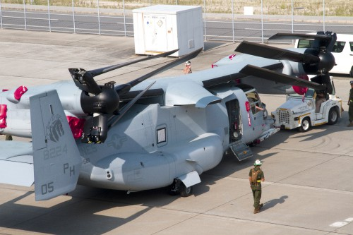 An MV-22 Osprey aircraft with Marine Medium Helicopter Squadron 265 is unloaded from the cargo ship Green Ridge at Marine Corps Air Station Iwakuni as part of the first MV-22 Osprey deployment to Japan. Photo by USMC Sgt. Daniel Brown, 07.23.2012. Source: https://www.flickr.com/photos/dvids/7629812448/