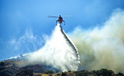 Firefighting helicopter douses a southern California wildfire north of Los Angeles. Photo by Ken Kistler, June 7, 2015.