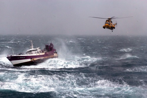 A Royal Air Force search and rescue Sea King helicopter comes to the aid of the French Fishing vessel Alf during a storm in the Irish Sea, March 21, 2013. Photo: Photo: Royal Navy/MOD.