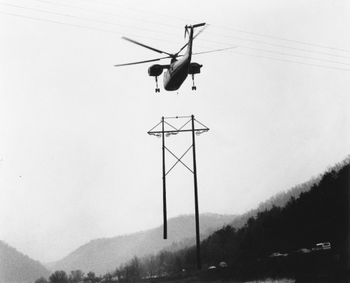 A Sikorsky H-37 (S-56) piston-engined heavy-transport helicopter carries a 9200-lb (4173 kg) transmission tower for installation by Appalachian Power Co. in the hills of West Virginia. The aircraft has been acquired by Helicrane Construction Corp (a subsidiary of Keystone Helicopter). of West Chester, PA.   From Vertiflite, January/February 1974 (page 18).