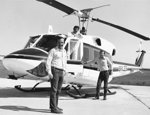 Pilots John Pond, left, and Gary Bertz, of Briles Wing & Helicopter, Santa Monica, CA, prepare to take a new Bell 212 to southern climes for off-shore oil rig support. The pair flank Bell Test Pilot Hank Stewart. From Vertiflite, January/February 1974 (page 18).