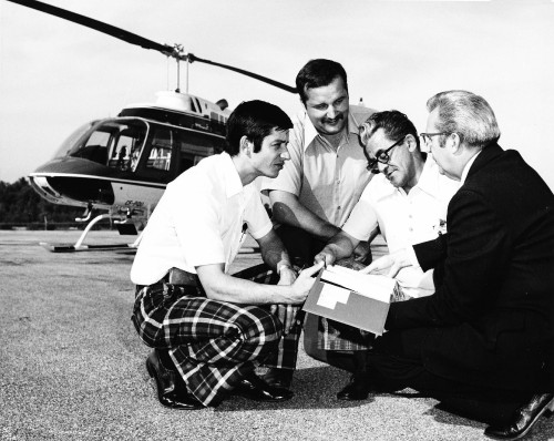 Members of the Quebec Police Force taking delivery of the 1000th Bell JetRanger. Looking over the helicopter's logbook are, from left, Leger Thibeault and Robert Duguay, QPF; Luc Desaulniers, Quebec Provincial DOT, and Bell's Commercial Marketing Manager, C.E. McGuire. Originally manufactured in Fort Worth, Texas, the Jet Ranger was later manufactured at Bell's plant in Mirabel, Quebec. From Vertiflite, March/April 1974 (page 29).