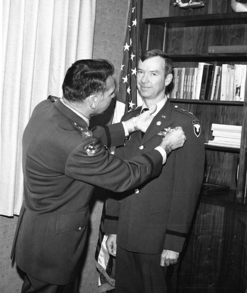 Lt. Col. Daniel C. Dugan, of the Army's Air Mobility R&D Laboratory (AMRDL), is presented his Master Aviators Badge by Col. Norman L. Robinson, AMRDL deputy director. Dugan, a 15-year Army veteran, acquired 3000 hours of flight time and received special instrument qualification to win the award. He is serving as a NASA/Army experimental engineering test pilot at Ames Research Center, Moffet Field, Calif. From Vertiflite, March/April 1974 (page 36).