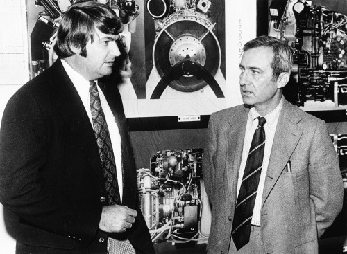 "Arnold Brooks, manager-Advanced Technology, of GE's Aircraft Engine Group, far right, is shown with Bud Carper, chairman of the Hampton Roads Chapter, after his talk on ""The Modern Helicopter Engine"" Sept. 25.  From Vertiflite, November/December 1974 (page 29)."
