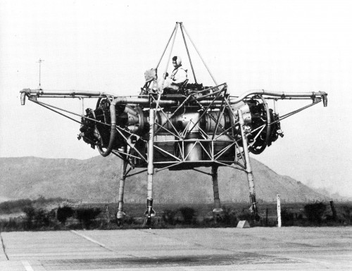 "The Rolls-Royce Flying Bedstead was the world's first jet powered VTOL aircraft. First free hover was on 3 August 1954. It was the first pure jet (manned and untethered) VTOL machine to take to the air successfully, to a height of 13 to 15 feet. Piloted by Ron T. Shepherd, chief test pilot for Rolls-Royce, the 7,196 lb craft was called the Rolls-Royce Thrust Measuring Rig (or TMR), but is better known by its unofficial name of the Flying Bedstead (Serial Number XA314). The TMR was the first manned untethered VTOL machine that used jet lift for free hover. From ""Golden Anniversary for VTOL"" by Erasmo Piñero, Jr. Vertiflite, Fall 2004 (page 50)."