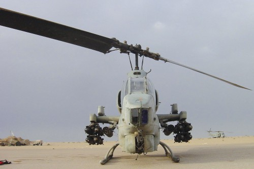 "Although equipped to carry the AGM-114 Hellfire missile, the AH-1W also frequently used the Raytheon TOW (tube-launched, optically-tracked, wire-guided) missile in Iraq and Afghanistan. The TOW provided a direct-fire weapon to complement the Hellfire's indirect ""lobbing"" missile profile. For example, Iraqi tanks would sometimes take shelter beneath highway overpasses, which protected them from Hellfire lobs, but left them vulnerable to straight TOW shots. From Vertiflite, Fall 2004 (page 24)."