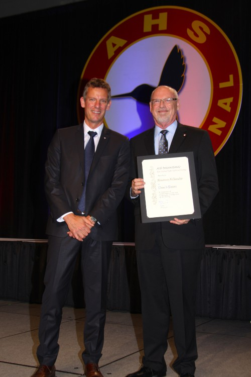 AHS Chair Jean-Brice Dumont presents a certificate recognizing Prof. David A. Peters, McDonnell Douglas Professor of Engineering at Washington University in St. Louis, as an AHS Honorary Fellow at Forum 73, May 10, 2017. Over five decades, Peters has made outstanding contributions in advancing rotorcraft technology, specifically in aeromechanics. Peters has also given generously of his time to serve AHS, including as a member of the AHS International Board of Directors, and as a past AHS Technical Director and Editor-in-Chief of the AHS International Journal. (AHS photo by Mark Upchurch)