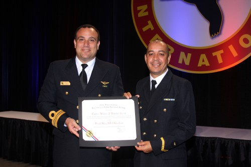 Winners of the 2017 AHS CAPT William J. Kossler USCG Award, Brazil Navy HS-1 Squadron Guerreiro 34, represented by LCDR Heitor Munaretto and NCPO Paulo Noronha, at Forum 73, May 10, 2017. The squadron is recognized for its extraordinary accomplishments during the nighttime rescue of the crew of the fishing vessel Beira Mar XXV on August 11-12, 2016. (AHS photo by Mark Upchurch)