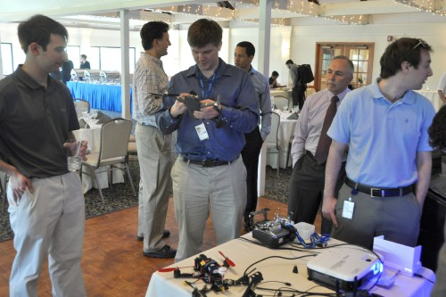 Stratford chapter members examine various drones brought in by presenter Erez Eller
