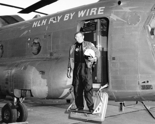 A.J Hutto, a Boeing Vertol Test Pilot in front of his HLH (Heavy Lift Helicopter). When completed, the helicopter will have fly by wire and the capacity to lift 35or more tons.   From Vertiflite, May/June 1975.