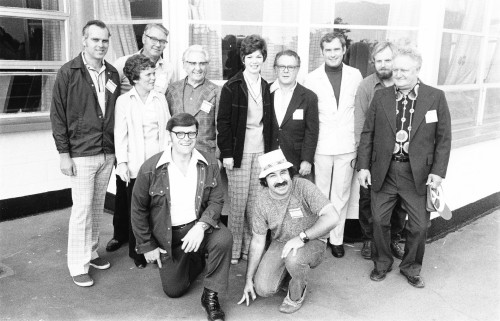 Photographed at the region's 19th outing and seafood feast at Ocean Beach Park, CT. Pictured are (standing, left to right) Jack Landgrebe, Louise Taranovich, Nick Caggianello, Joe Cottel, Mrs. Karen Caggianello, Max Bellard, David O. Smith, Fred Hartman and Ralph P. Alex. Kneeling are Ed O'Leary and Ugo Zullo.       From Vertiflite, November/December 1975.