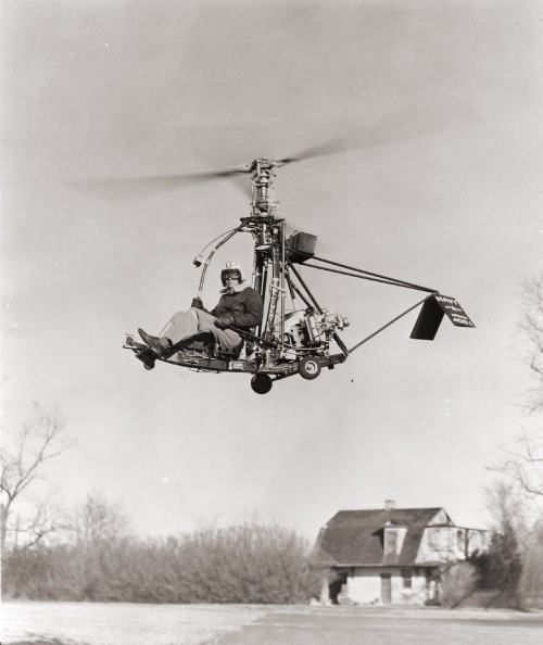 "Built by the Gyrodyne Corporation of America, the ""Rotorcycle"" series of coaxial helicopters were developed for potential use by the US Navy. Intended to be deployed aboard Navy destroyers, the Rotorcycles were designed to carry a single torpedo and to operate as unmanned drones. In this image, a GCA-41B (US Navy designation XRON-1) is being tested at the company's St. James, NY location. The pilot is James V. Ryan of Smithtown. From AHS Newsletter, November 1961 (page 8)."