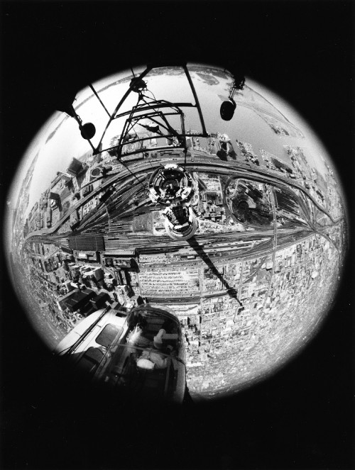 The World's tallest man-made structure and a panorama of Toronto spreads out under an Erickson Air Crane  S-64E, giving the passenger a bird's eye view of Toronto from a fisheye lens in the bottom of the aircraft.  From Vertiflite, May/June 1975.
