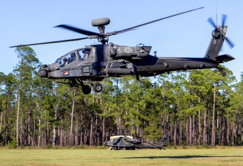 Army pilots hover after maneuvering an AH-64D Apache helicopter into firing position during an aerial gunnery exercise at Fort Stewart, Ga., Oct. 22, 2016. US Army photo by Spc. Scott Lindblom. Source: https://www.defense.gov/Photos/Photo-Gallery/igphoto/2001659274/