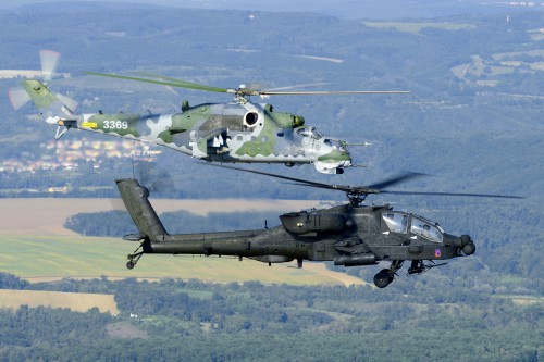 Capt. Matthew C. Martel and Chief Warrant Officer Randy Peterson of 12th Combat Aviation Brigade fly an Apache AH-64 attack helicopter in formation with a Czech Air force Mi-24/35 attack helicopter. (Photo Credit: Lt. Tomas Chlebecek)
