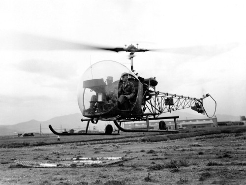 "Maj. Michael J. Stoke, executive officer, 79th Ordnance Aircraft Maintenance Battalion, U.S. Eighth Army, and Capt. Charles C. Blake, a chaplain known as the ""flying chaplain,"" depart by helicopter to visit 79th Ordnance units in Korea, June 8, 1953. (Photo Credit: U.S. Army)"