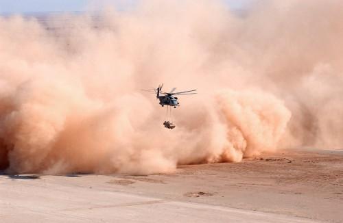 Dust swirls around a CH-53E Super Stallion. Photo 2005 Defense Logistics Agency, 3rd Marine Aircraft Wing Public Affairs.