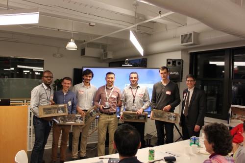 The Trivia Challenge winners claim their RC BlackHawks from AHS ENE Chapter President Harry Nahatis (far right).