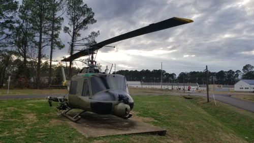 UH-1M Huey outside the US Army Program Executive Office (PEO) for Aviation. AHS photo taken at Redstone Arsenal, Huntsville, Alabama, Feb. 20, 2018. The -1M was an engine upgrade to the -1C. This aircraft, 64-14185, was restored to Vietnam colors by BLAST OFF, Inc., Nov. 14, 2017.