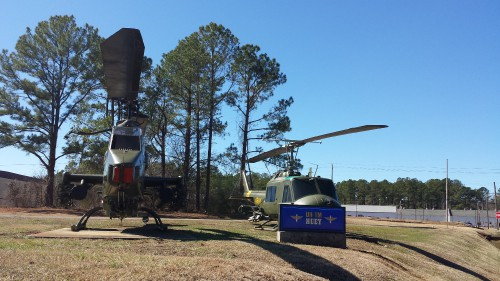 AH-1F Cobra and UH-1M outside the US Army Program Executive Office (PEO) for Aviation. AHS photo taken at Redstone Arsenal, Huntsville, Alabama, Feb. 21, 2014.