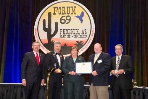Winner of Grover E. Bell Awrad at Forum 69 Awards, 2013 - Kiowa Warrior Aerodynamics Improvement Team, accepting the award from Steve Mundt  on behalf of their teams were MG Tim Crosby, Program Executive Officer - Aviation, US Army, Ms. Susan Gorton, Program Manager, Subsonic Rotary Wing Program, NASA, Dr. Preston Martin, US Army Aeroflightdynamics Directorate and Mr. Tom Wood, Senior Technical Fellow, Bell Helicopter.