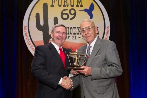 Winner of John J. Schneider Historical Achievement Award at Forum 69 Awards, 2013 - Frank Harris, F. D. Harris & Associates (right), accepting the award from Steve Mundt.