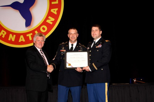Winner of Captain William J. Kossler, USCG Award at Forum 68 Awards, 2012 - The C Company, 1-52nd Aviation Regiment, United States Army.  Representing the regiment was MAJ Shane Mendenhall (center) and 1SG Jeff Pinnell (right), with Phil Dunford on stage.