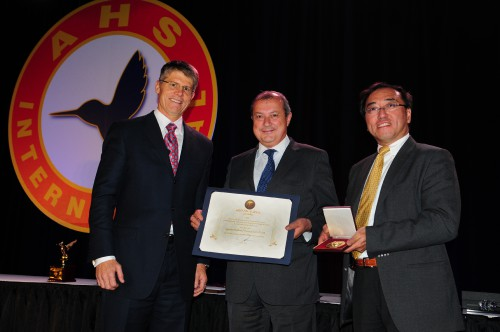 Winner of Grover E. Bell Award at Forum 70 Awards, 2014 is the AgustaWestland Project Zero Team: accepting the award on behalf of their team were Luciano Marcocci and Dr. James Wang, AgustaWestland from John Garrison, President and CEO of Bell Helicopter Textron Inc.