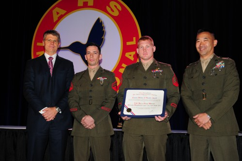 "There were two winning teams for Captain William J. Kossler, USCG award at Forum 70 Awards, 2014- the second group of honorees : the U.S. Marine Corps Medium Tiltrotor Squadrons VMM-262 and VMM-265. These Squadrons were represented by the VMM-262 ""Flying Tigers"" squadron with LtCol Joseph Lee, Sergeant Dustin Cato (V-22 Crew Chief), and Corporal Caleb Gordy (V-22 Mechanic). Major Joe ""J-Lo"" Mederos accepted for the VMM-265 ""Dragons"" squadron."