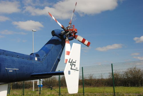There are fins on both sides of the aircraft.   Photo taken at The Helicopter Museum, Weston-Super-Mare, UK. Note: Ground equipment is fitted and shown by orange/red items.  Image donated to AHS International (image provided under the terms Creative Commons license Attribution-ShareAlike 4.0 International (CC BY-SA 4.0))