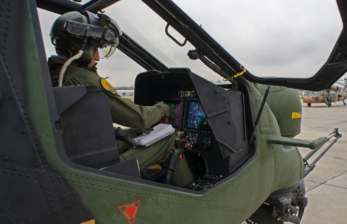 TAI T-129 ATAK EDH of Turkish Army Aviation at Ankara-Guvercinlik AAB (TR) on 2015-09.30 - Close up of the full digital cockpit with the pilot checking all the parameters before flying
