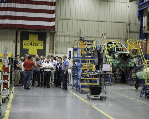Photo of one of the Forum 74 tour groups at the Boeing Mesa Apache production line, Friday, May 18, 2018. Boeing photo for the Vertical Flight Society by Mike Goettings. CC BY-NC-SA 3.0