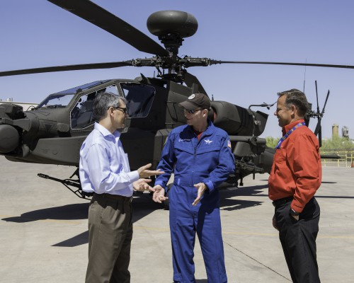During the Forum 74 Tour at Boeing Mesa (L-R): Mike Hirschberg, Vertical Flight Society Executive Director, gets an update on the Apache program from Bill Lee, Boeing Attack Helicopters Test Pilot, and Shane Openshaw, Boeing Director of Attack Helicopter Programs. Boeing photo for the Vertical Flight Society by Mike Goettings, Friday, May 18, 2018. CC BY-NC-SA 3.0
