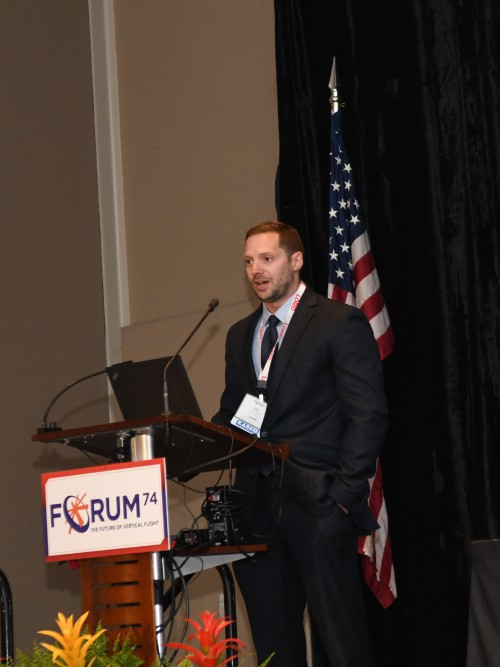 Presentation by Ben Wimberly, H-60M Futures Team Lead, Utility Helicopters Project Office, US Army's Program Executive Office (PEO) Aviation, at the Forum 74 Army Aviation Program Managers Special Session on Tuesday morning, May 15, 2018. VFS Photo by Kenneth I. Swartz. CC BY-SA 3.0