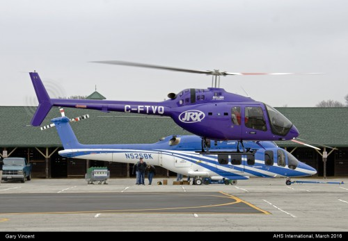 A photo of the Bell 505 and Bell 525 at Heli-Expo 2016. Photo taken by Gary Vincent.