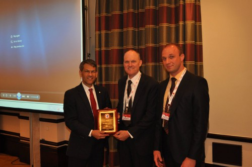 Mike Hirschberg (AHS), presents the Alfred Gessow Award to Matthew Whalley (US Army Aeroflightdynamics). VFS Photo.