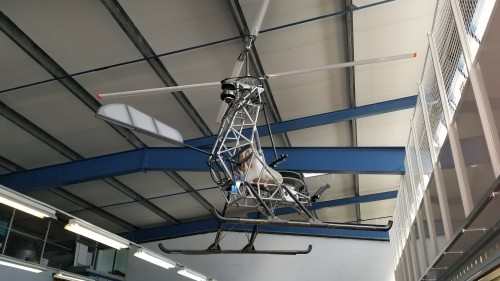 World's first electric helicopter, hanging at the Solution F headquarters, Venelles, France. The lower half of the vertical stabilizer was eliminated during hover testing. VFS photo taken June 22, 2018. CC-BY-SA 3.0.