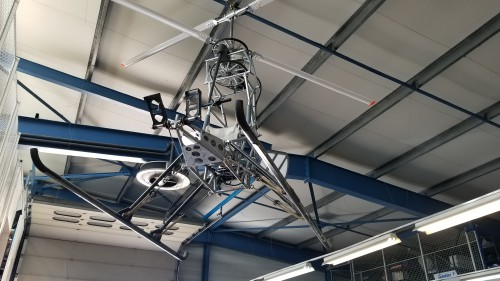 World's first electric helicopter, hanging at the Solution F headquarters, Venelles, France. The battery, normally under the seat, has been removed. VFS photo taken June 22, 2018. CC-BY-SA 3.0.