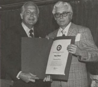 Honorary Fellows Award, 1976 was awarded to Mr. Wayne Wiesner at Forum-32 for his contributions to the Society.