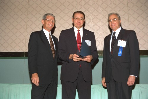 The AHS Supplier Excellence Award, 1996, Forum 52, accepted by Lord Corporation President Dr. Chuck Hora.  Lord is the first recipient of this award as an industry leader in the design and manufacture of helicopter and tiltrotor vibration isolation and damping systems, including elastomeric bearings and dampers.  Forum 52 Awards Banquet at the Sheraton Washington Hotel, Washington, D.C., June 5, 1996. VFS photo. CC BY-SA 4.0.
