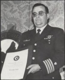 Captain William J. Kossler, USCG Award at Forum 37, 1981 presented to US Coast Guard 17th District (Juneau, Alaska) for their part what has been called the greatest sea rescue in modern history - Prinsendem Rescuers honored. Forum 37, May 17-20, 1981 at New Orleans, Louisiana USA