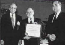 The Robert L. Pinckney Award at Forum 53, 1997, presented by Gary Rast (left) and George T. Singley, III to the winner V-22 Airframe Integrated Product Team, represented by Dave Snyder, Technical Director for the Bell-Boeing Joint Program Office.  Forum 53, April 29-May 1, 1997, Virginia Beach, Virginia USA