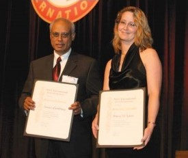 At Forum 61, 2005, Honorary Fellowship awarded to Somen Chowdhury, and Edwin Aiken, for both recipients are long-time members of the Society and have greatly contributed to the stature of AHS.  Pictured are Somen Chowdhury (left) of Bell Helicopter Canada and Laura Iseler, accepting on behalf of Edwin Aiken, NASA Ames Research Center, with their Honorary Fellow certificates. Forum 61, June 1-3, 2005, Grapevine, Texas USA