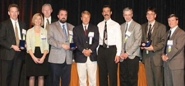 Howard Hughes Award presented to The Sikorsky Active Vibration Control Development  Team, which includes Dynamic Controls- Hamilton Sundstrand and Sikorsky Aircraft Corp., at Forum 61, held on June 1-3, 2005, Grapevine, Texas USA. The team developed and gained FAA certification of a robust, self-adaptive active vibration control system on the S-92 helicopter. This successful development helped spur the US Army to decide to select the AVC as the baseline vibration reduction system for the UH-60M Black Hawk.