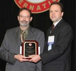 "Robert L. Lichten award presented to Jonathan K. Garhart, Sikorsky Aircraft Corp. at Forum 61, 2005.  The title of his paper is ""Implementation of Carbon Fiber Composites in Rotorcraft Transmission Housing Applications."" Forum 61, June 1-3, 2005, Grapevine, Texas USA"