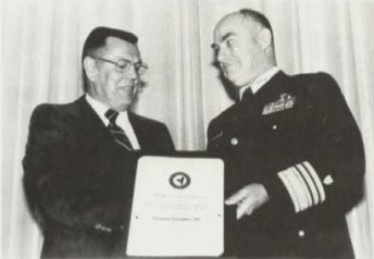Captain William J. Kossler, USCG Award 1979 at Forum 35 Awards Luncheon presented to Columbia Helicopters, accepted by Wesley Lematta.