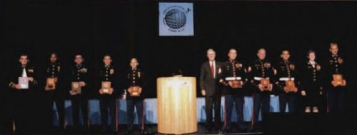Frederick Feinberg Award presented to US Marine Corps 15th and 26th  Marine Expeditionary Units at annual Forum 58 Awards, 2002,  for their participation in the Base Rhino, Afghanistan Seizure on November 26, 2001, at annual Forum 58, 2002.  Forum 58, June 11-13, 2002, Montréal, Québec Canada