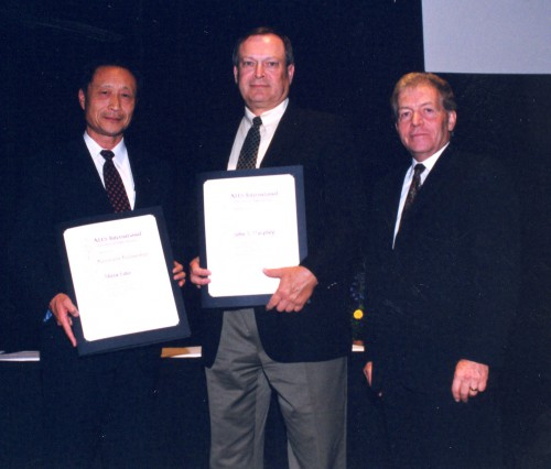 Honorary Fellowship awarded to Akira Sato,Churyo Engineering Co.,Ltd.; and John R. Murphey, Bell Helicopter Textron, Inc., for their significant contributions towards furthering the goals of AHS International, at annual Forum 59 Awards in 2003. Roy Battles accepted the award on behalf of John R. Murphey.  Forum 59, May 6-8, 2003, Phoenix, Arizona USA