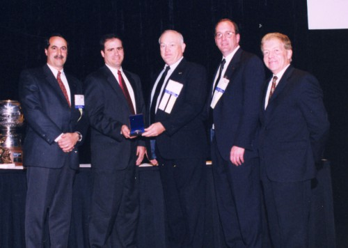 Howard Hughes Award 2003 presented to Sikorsky S-92 Flaw-Tolerance Design and Test Team at annual Forum 59 Awards. Accepting the award from Gilles Ouimet is John M. Palumbo, David O. Adams, Gregg J. Ambrose and David Zinni, all of Sikorsky Aircraft Corp.  Forum 59, May 6-8, 2003, Phoenix, Arizona USA