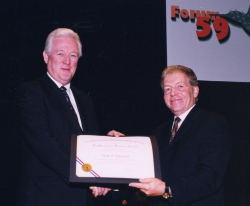 Dr. Alexander Klemin award presented to Dean C. Borgman, President, Sikorsky Aircraft Corp., for his long and distinguished career in helicopter industry, at annual Forum 59 Awards in 2003. Gilles Ouimet, right, salutes Dean C. Borgman.  Forum 59, May 6-8, 2003, Phoenix, Arizona USA